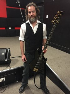 "Mark ""Milli"" Avery almost cracks a smile, with his returned bass"